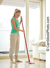happy woman with mop cleaning floor at home - people,...