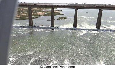 Fast train on a river bridge