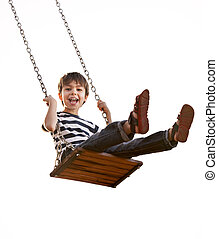 Cute boy playing on swing, having fun. On a white...