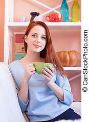 d girl in blue blouse with green cup - Redhead girl in blue...