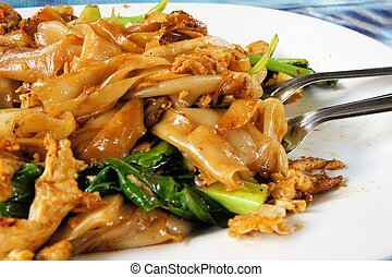 Pad See Ew, flat rice noodle stir fried with beef. - Pad See...