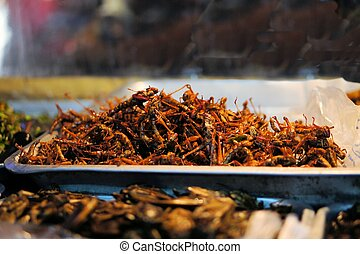 Fried grasshoppers at a Thai market - Fried grasshoppers...
