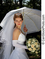 Young bride under parasol - Half body portrait of young...