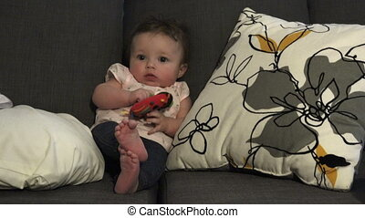 Baby Seated Playing With Toys