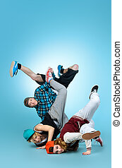 hip-hop group - Group of young modern dancers dancing...