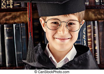 university kid - Smart boy stands in the library by the...