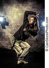 show hip-hop - Modern hip-hop dancer over grunge background.