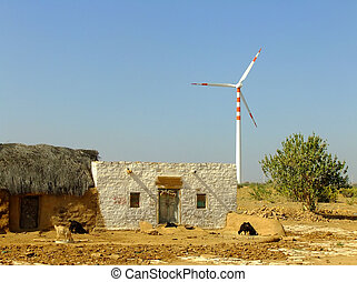 Small village with traditional houses and windmills in Thar dese