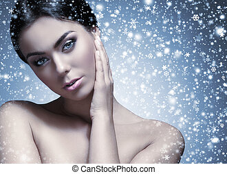 Portrait of young and beautiful woman over grey - Portrait...