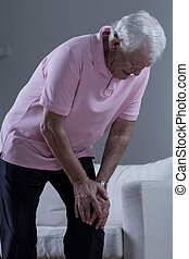 Man with osteoarthritis - Senior sick man with painful...