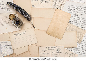 Old letters, vintage postcards and antique feather pen Mock...