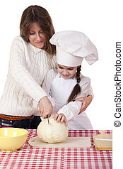 Cooking and people concept - Little girl in cook hat and...