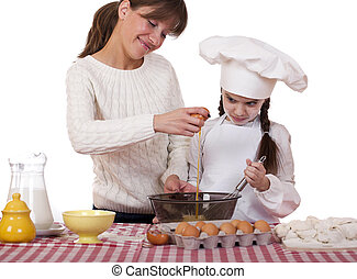 Happy mother with little daughter joyful cooking, isolated...