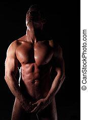 uomo nudo - seminude muscular man black background