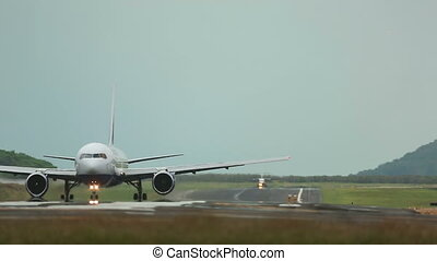 Taxiing - Airplanes taxiing on the runway, International...