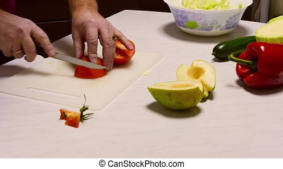 Cooking salad - Man sliced tomato for vegetable salad