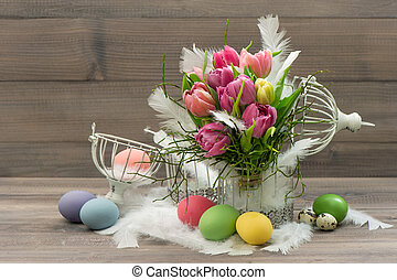 tulip flowers with colored easter eggs