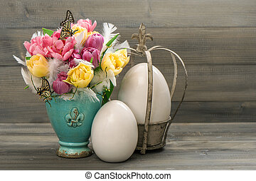 tulip flowers with vintage easter eggs decoration retro...