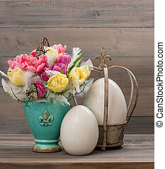 tulip flowers with vintage easter eggs
