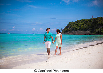 Young happy couple have fun on brach vacation