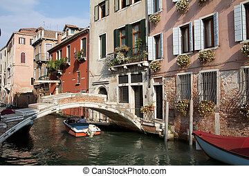 Small Venetian Bridge - Powerboat traveling under bridge...
