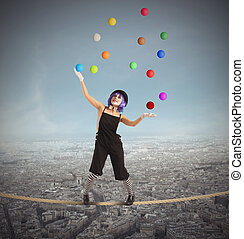 Clown difficult balance - Clown as juggler is balancing on...