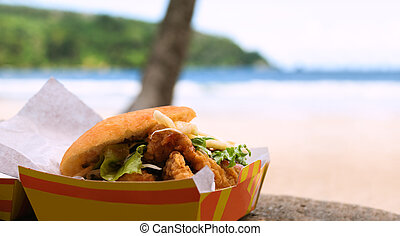 Fried shark and bake fast food outdoors by the beach at...