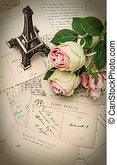 roses, antique french postcards and souvenir Eiffel Tower...