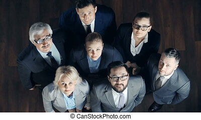 Keep It Up - Direct from above view of business team looking...