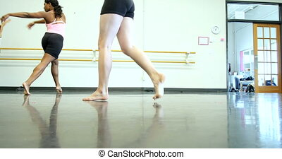 Ballet dancers ballerinas practicing and rehearsing inside a...