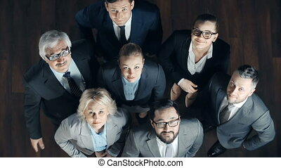 Friendly Gesture - Above view of seven business people...