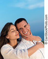 happy young romantic couple have fun arelax relax at home -...