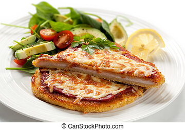 Schnitzel with Salad - Delicious chicken schnitzel topped...