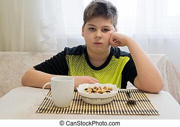 adolescent, Garçon, a, flocons avoine, pour, petit déjeuner,...
