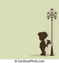 Boy with a bouquet of standing under a street lamp....