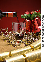 Christmas Red Wine - Red wine being poured in a christmas...