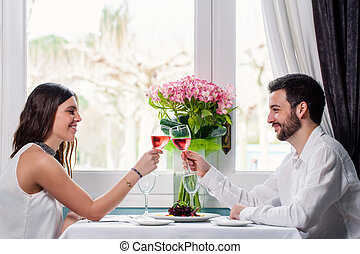 Cute couple having romantic dinner. - Close up portrait of...