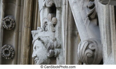 An image of the faces sculpted on the wall of Westminster...