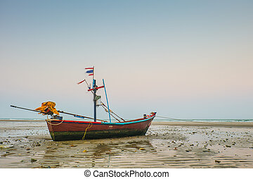 Traditional fishing boat on beach