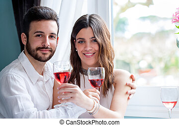 Young couple on date in restaurant.