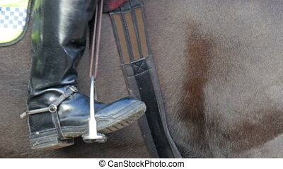 The black boots of the guard on a horse - The black boots of...
