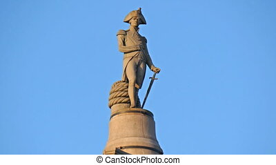 A statue of a knight with his sword in him