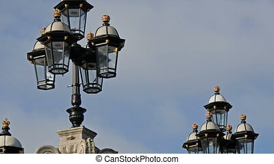 The huge gate and lamps from the Buckingham Palace. Showing...