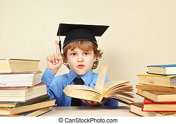 Little boy in academic hat quoted old book - Little boy in...