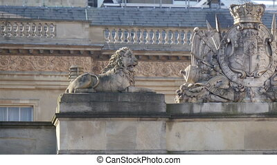 A lion and a horse statue on the palace