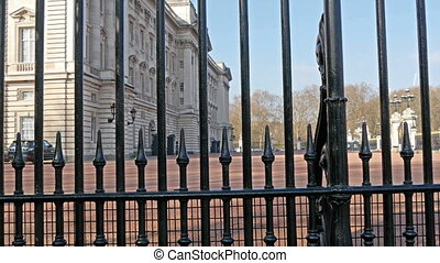The black gate of the Buckingham Palace From the gate you...