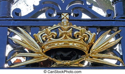One of the golden sculptures of the gate in Buckingham...