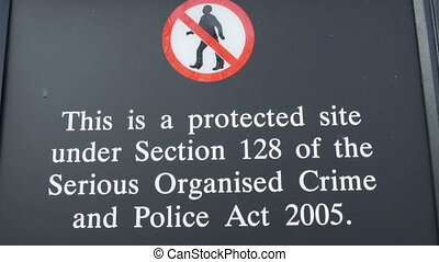 A signage saying no trespassing on the area It is a black...