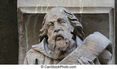 One of the stone sculptures from the wall of the church of...