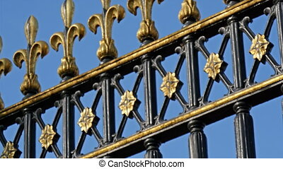 The black and golden gate of the Buckingham Palace with the...
